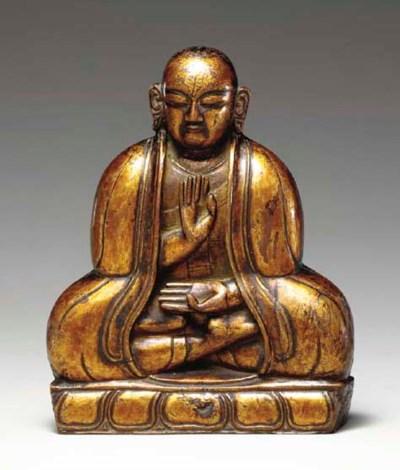 A Gilt Lacquered Wood Figure o