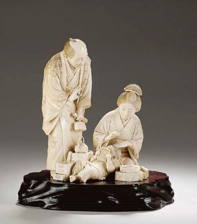 An Ivory Figure Group (Okimono