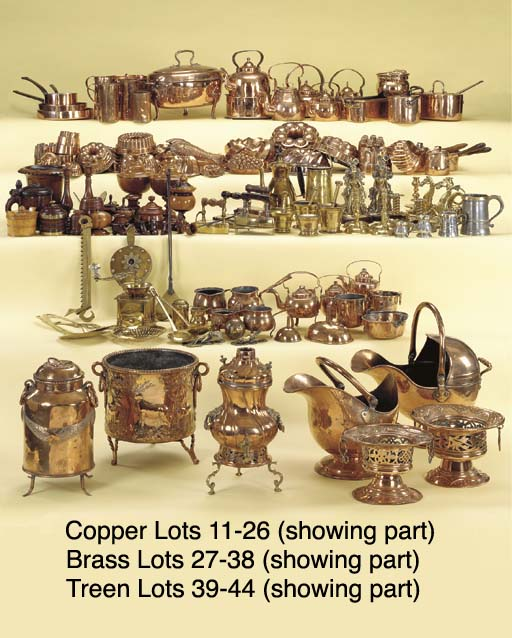 A GROUP OF COPPER KETTLES AND