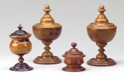 A GROUP OF TREEN URNS,
