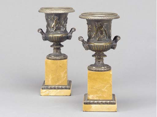 A PAIR OF ENGLISH BRONZE AND O