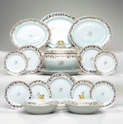 AN INITIALLED DINNER SERVICE,