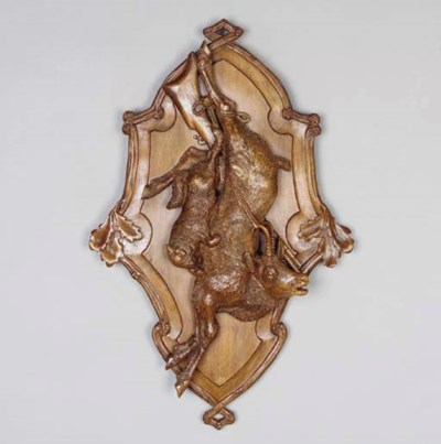 A Continental carved wood hunt