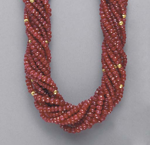 A MULTI-STRAND RUBY, DIAMOND A