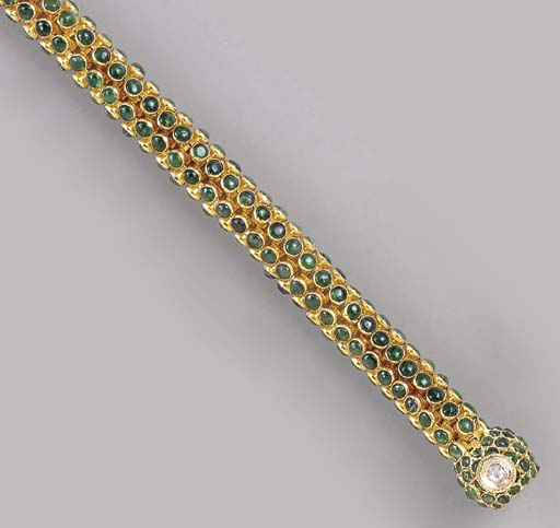 AN EMERALD AND 18K GOLD NECKLA