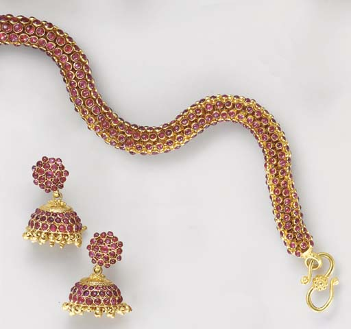 A GROUP OF RUBY AND 18K GOLD J