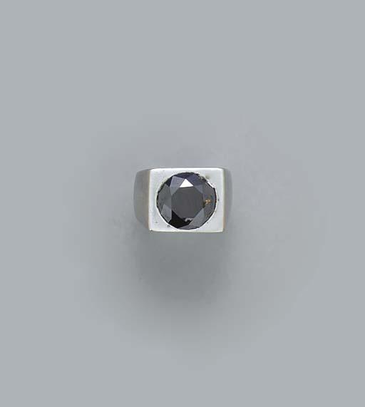 A BLACK DIAMOND AND 14K WHITE
