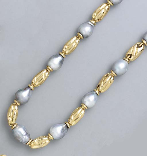 A GRAY BAROQUE PEARL AND 18K G