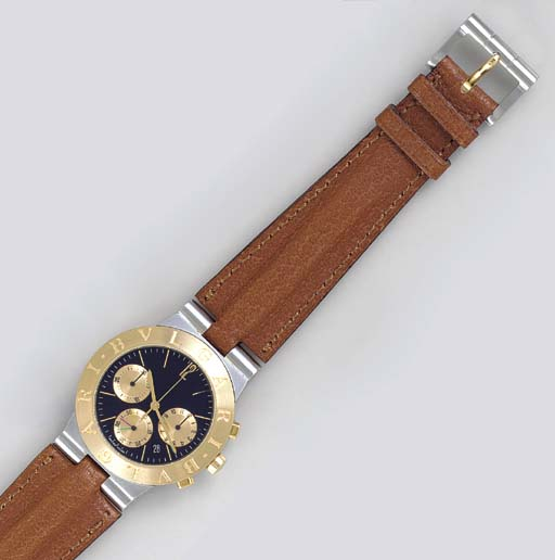 A STAINLESS STEEL AND GOLD CHR