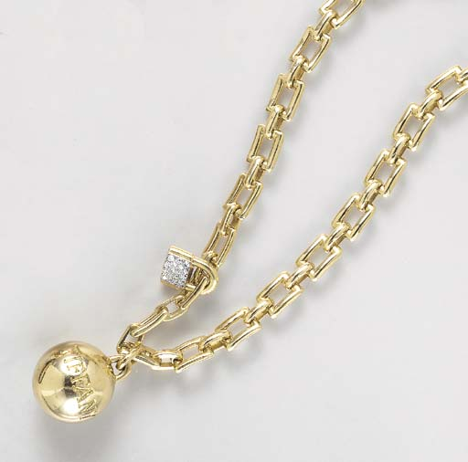 AN 18K GOLD BALL AND CHAIN BRA