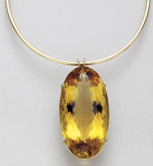A CITRINE AND GOLD PENDENT NEC