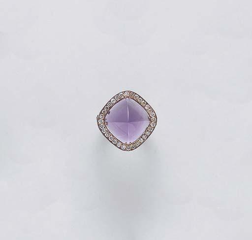 AN AMETHYST, COLORED DIAMOND A
