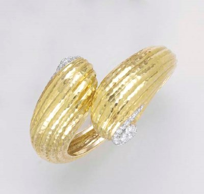 AN 18K GOLD, DIAMOND AND PLATI