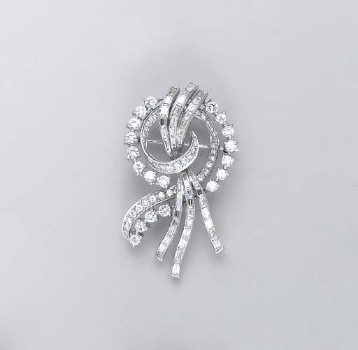 A DIAMOND AND PLATINUM SCROLL