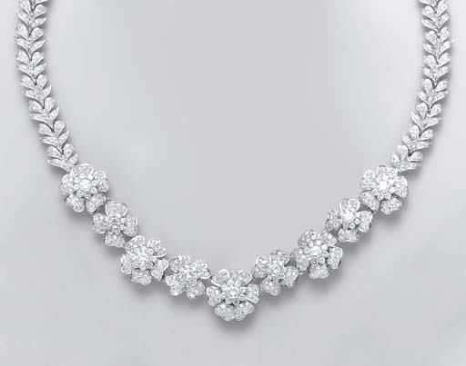 A DIAMOND AND 18K WHITE GOLD F