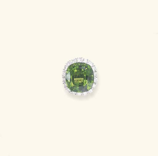 A PERIDOT AND DIAMOND RING
