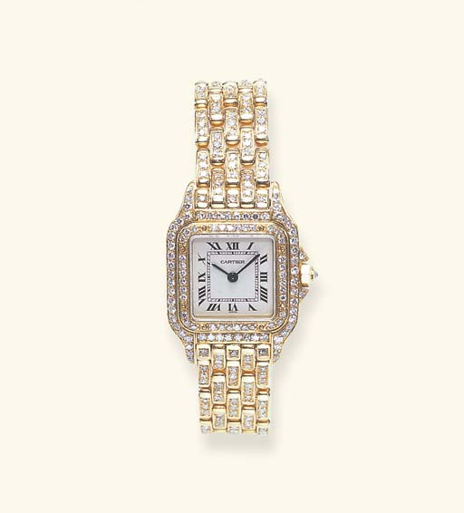A DIAMOND AND GOLD WRISTWATCH,