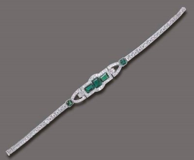 AN ELEGANT ART DECO EMERALD AN