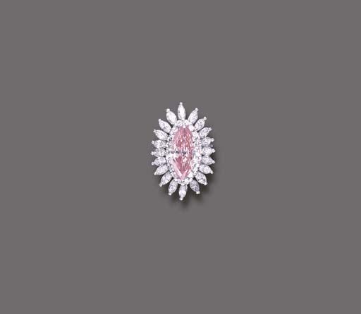 A FANCY ORANGY PINK DIAMOND RI