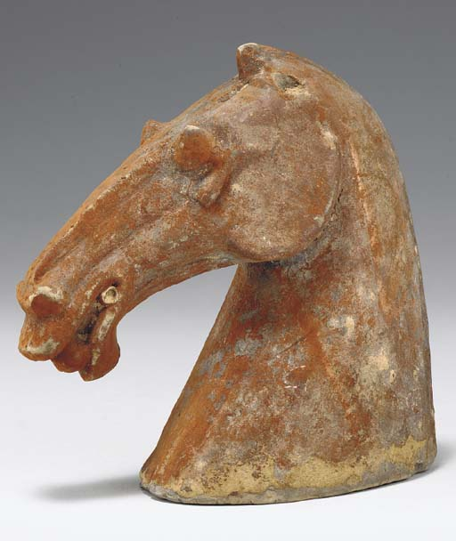A PAINTED GREY POTTERY HORSE H