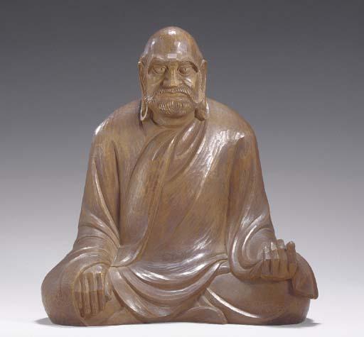 A Wood Sculpture Of Daruma