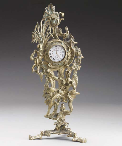 A GEORGE II BRASS WATCHSTAND,