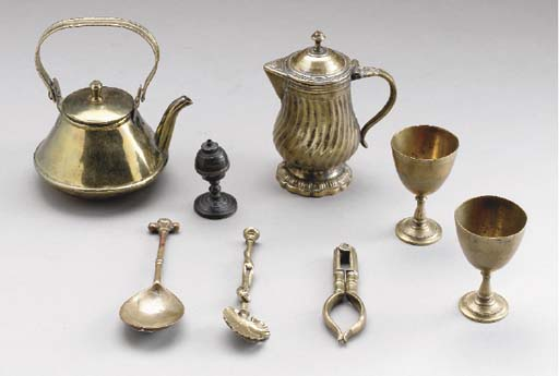 A GROUP OF SMALL BRASS OBJECTS