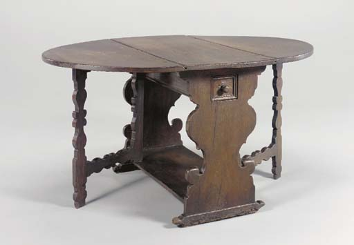 A SPANISH OAK DROP-LEAF TABLE,
