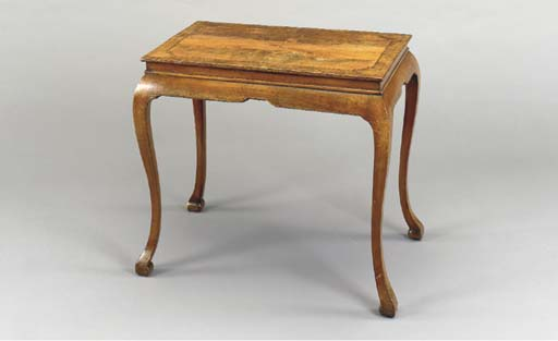A GEORGE I WALNUT CENTER TABLE