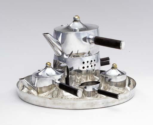 A SILVERED BRASS TEA SERVICE