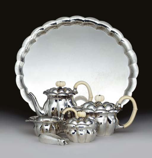 A HAMMERED SILVER AND IVORY TE