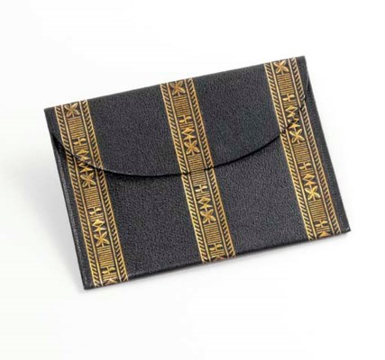 A GILT-TOOLED LEATHER CARD WAL