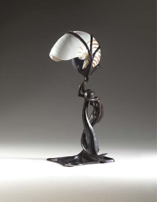 A BRONZE 'NAUTILUS' LAMP