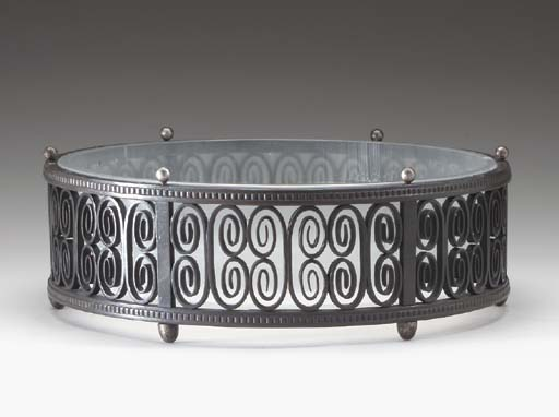 A WROUGHT-IRON TABLE JARDINIER