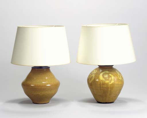 TWO OCHRE-GLAZED CERAMIC LAMP