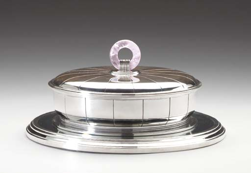 A SILVER TUREEN AND COVER ON M