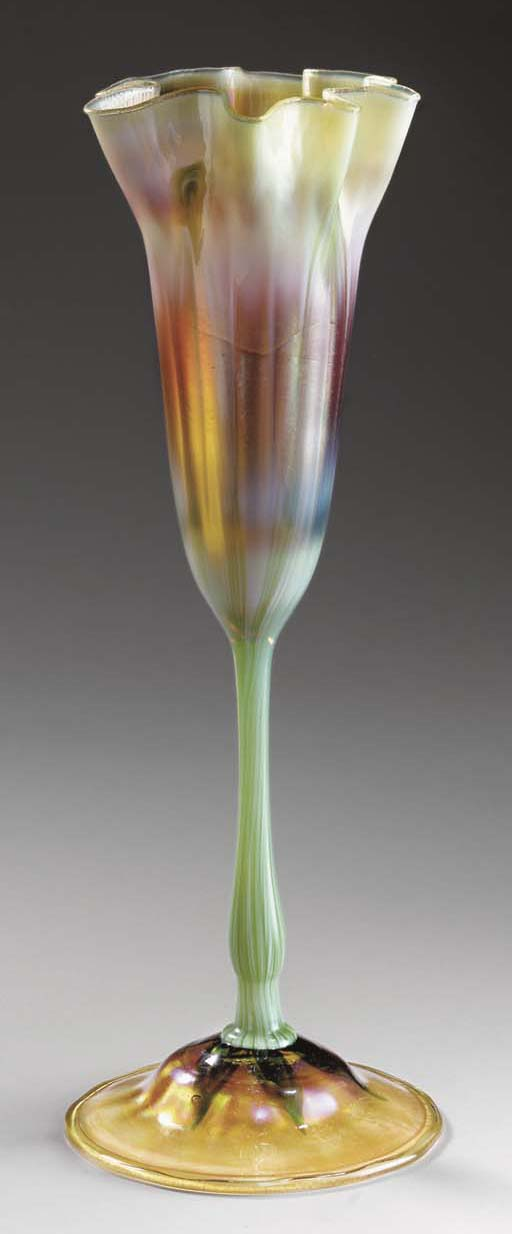 A DECORATED FAVRILE GLASS FLOW