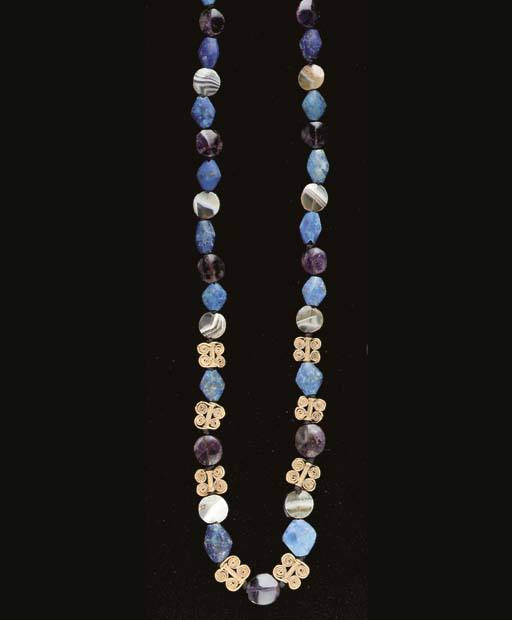 A SUMERIAN GOLD AND STONE BEAD