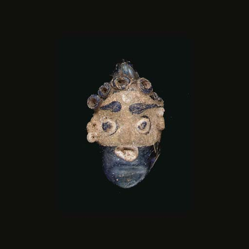 A CARTHAGINIAN GLASS HEAD PEND