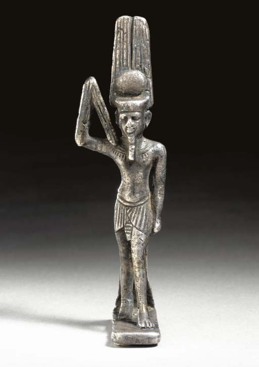AN EGYPTIAN SILVER AMULET OF A