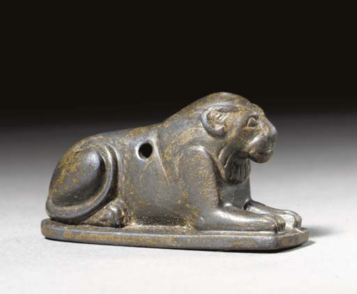 AN EGYPTIAN HEMATITE LION AMUL