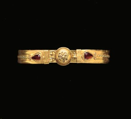 A GREEK GOLD AND GARNET BRACEL