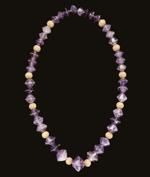 A GREEK AMETHYST AND GOLD BEAD