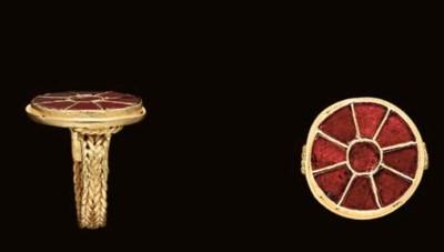 A MEROVINGIAN GOLD AND GARNET