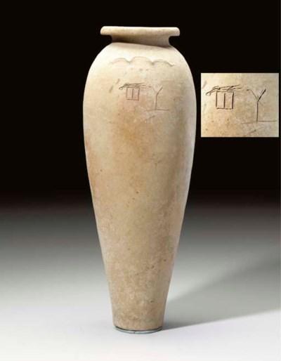 AN EGYPTIAN POTTERY WAVY-HANDL