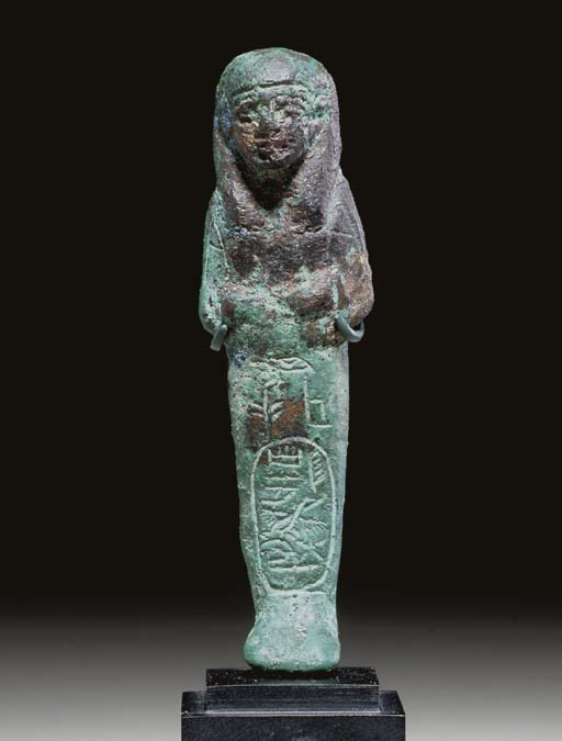 AN EGYPTIAN BRONZE ROYAL SHABT