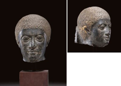 AN EGYPTIAN GRANITE HEAD OF A