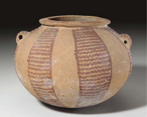 AN EGYPTIAN POTTERY JAR