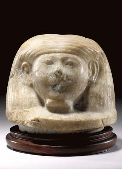 AN EGYPTIAN CALCITE-ALABASTER