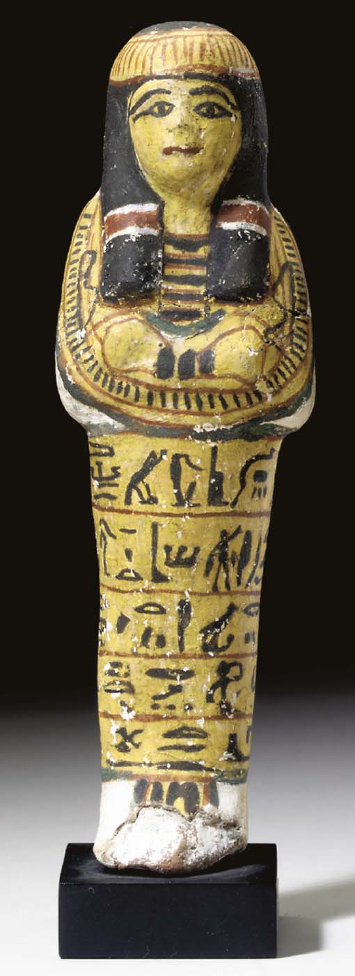AN EGYPTIAN PAINTED TERRACOTTA